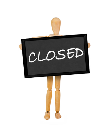 stating: mannequin holding a  blank blackboard stating closed Stock Photo