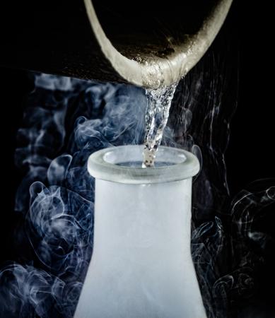 nitrogen: liquid nitrogen being poured from a beaker into a flask