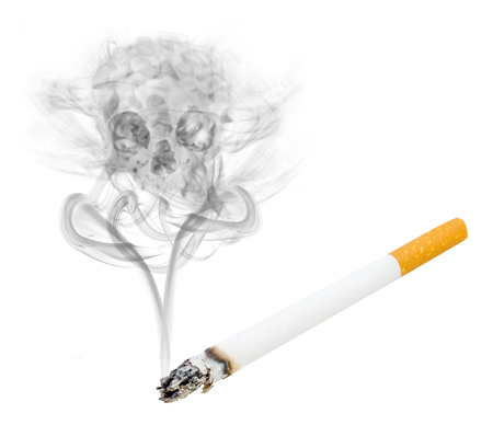 concept of smoke rising from cigarette forming a skull Stock Photo