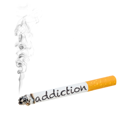 A burning cigarette with the word addiction on the side