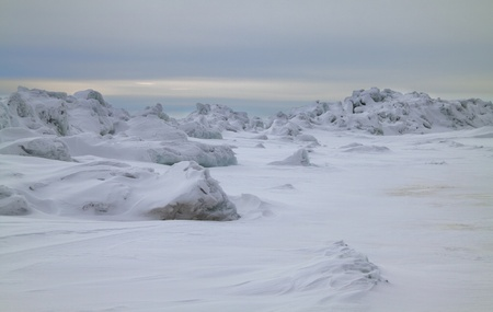 conglomeration: Quiet  winter evening on the frozen sea with ice conglomerations Stock Photo