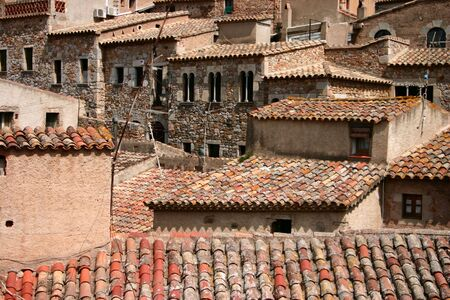 crowded space: Crowded stone houses jostle for space in the old town of Tossa de Mar Catalonia Spain