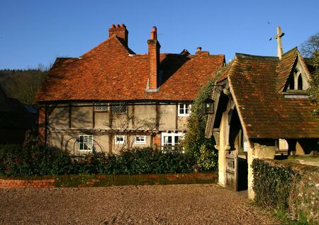 Rustic cottage and Church Entrance Porch in the Buckinghamshire village of Hambleden UK Stock Photo - 2795455