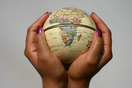 dominion: Conceptual image of female holding a globe, Africa to the forefront, could be used to illustrate many globalpower issues