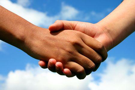 mani che si stringono: Mani di amicizia  Archivio Fotografico