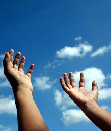imploring: Hands raised unto the heavens as if in a gesture of spiritual supplication