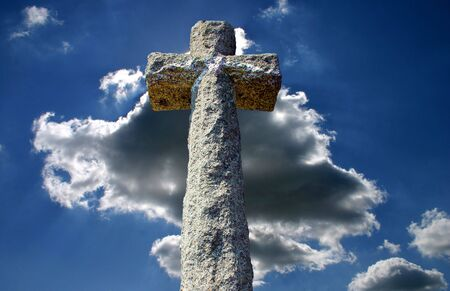 piety: Stone Cross Against Cloudy Sky