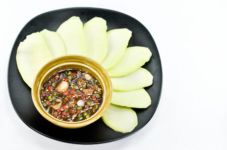 mango fish: A slice Mango with Sweet Fish Sauce Stock Photo