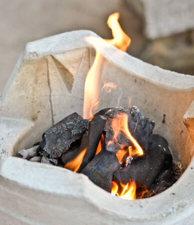 fire on charcoal stove  photo
