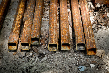 decompose: A rustic Carbon Steel Square Tube Stock Photo