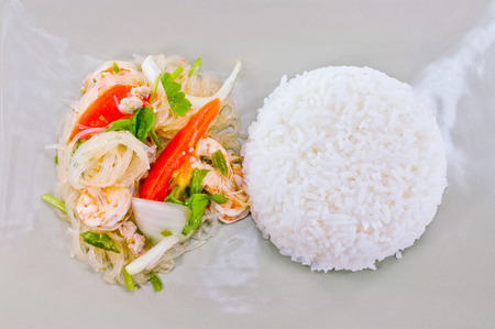 Spicy Glass Noodles with Thai Hom mali Steam Rice in bowl photo