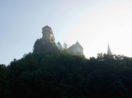 Castle on Rock in Morning Haze Stock Photo