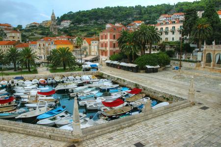coastal city: Historical Center of Coastal City with Harbouring Fishing Boats Stock Photo
