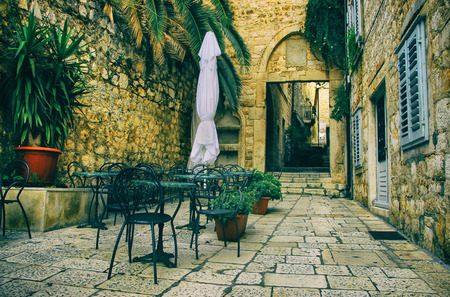 coffeehouse: Small Romantic Coffeehouse in Old Historical Street Stock Photo