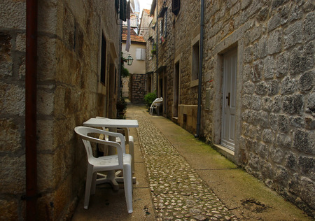 mopeds: Old Historical Romantic Street with White Chairs