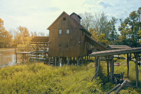 water mill: Wooden Water Mill on River with Sunshine