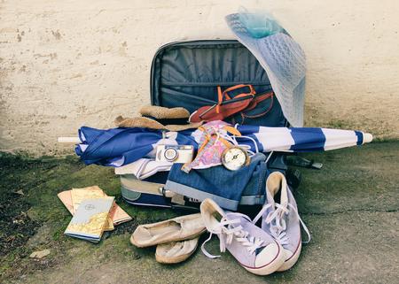 sun umbrella: Travel Suitcase with Sun Umbrella and Maps Stock Photo