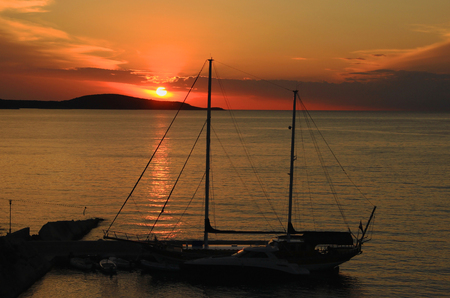 ketch: Yacht Harbouring in Sunset