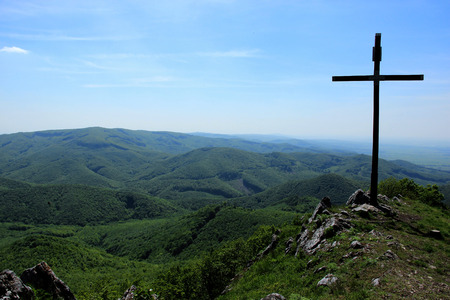panoramatic: Wide View of Forested Hills of Range of Mountain with Big Crucifix on Top