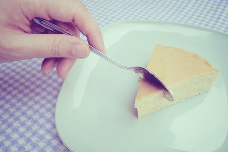 avocation: Slice a piece of butter cake by spoon, vintage filter