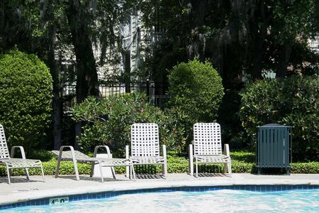 chairs by the edge of the pool represent peace and relaxation