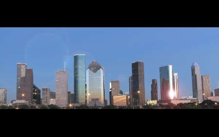 sunset reflected on houston downtown skyscrapers