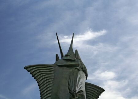 monument of swordfish with sky background photo
