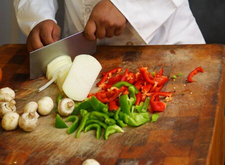 close up chef cutting vegetables