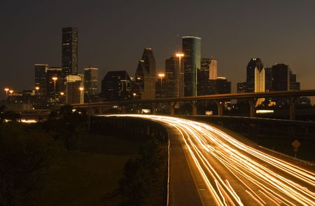 view of downtown houston framed cars light on highway Stock Photo
