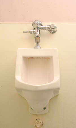 urinal: classic dirty urinal in the restroom