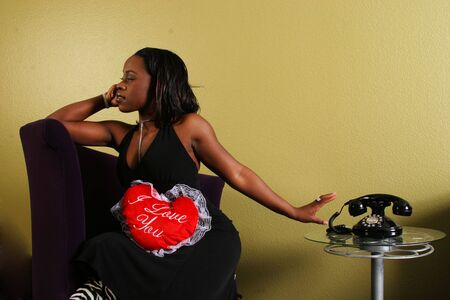 glum: african american woman get upset and refusing to answer the phone from her boyfriend