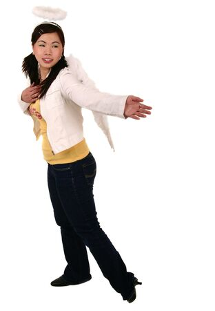 helping others: asian girl wearing angel wing with her hand reaching to her back about to helping others Stock Photo