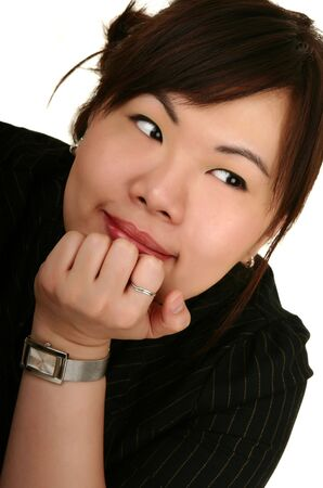 smiling asian girl leaning forward on her hand and look to her left Stock Photo - 1267879