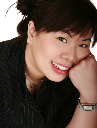 asian girl leaning on her left hand and smile photo