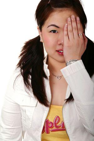 pretty asian girl closing her left eye photo