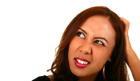 smoothen: expression of confused woman holding her head. skin was smoothen no noise reduction used