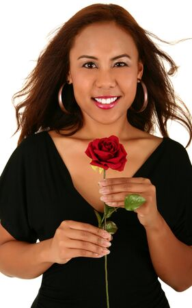 smoothen: fashion shot of woman holding red rose. skin was smoothen no noise reduction used