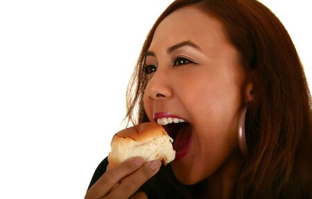smoothen: isolated woman eating bread. focus on bread. skin was smoothen no noise reduction used