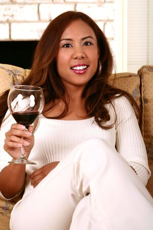 smoothen: casual shot of woman holding wine. skin was smoothen no noise reduction used