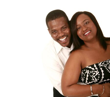 half body shot of african american couple holding each other. isolated on white