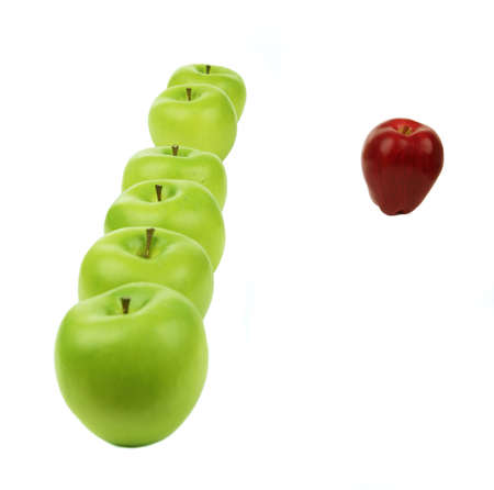 loss leader: a vertical line of green apples and a red apple sit in the front of them