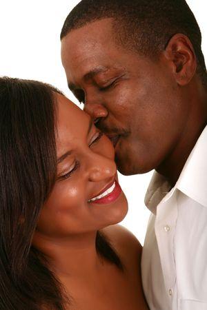african american husband romantically kiss his wife Standard-Bild