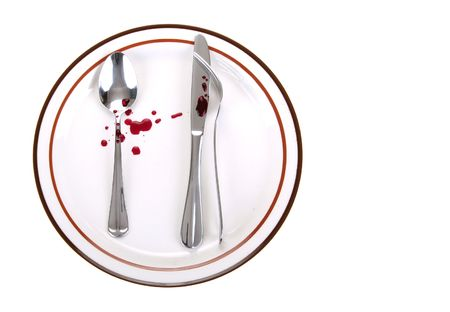an odd position of spoon and knife and fork touch each other on a dinner plate. crime-scene-like setup Stock Photo - 2102809