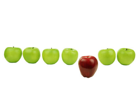 loss leader: a horinzontal line of green apples with red apple sit in front of them Stock Photo