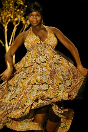 pregnant african american woman dancing with skirt on. there are some degree of noise on cetrain area Banco de Imagens