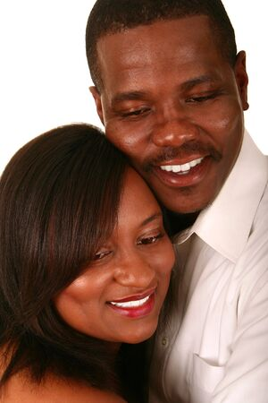 romantic african american couple holding each other closely photo