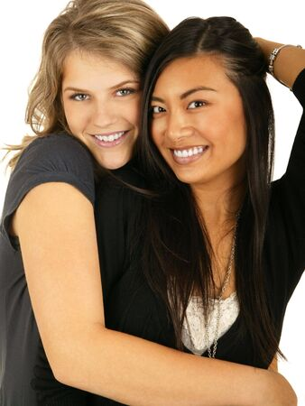 vietnamse: isolated asian and caucasian girls hugging each other showing concept of best friend