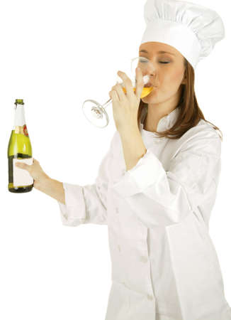 chef drinking champagne and holding champagne bottle photo