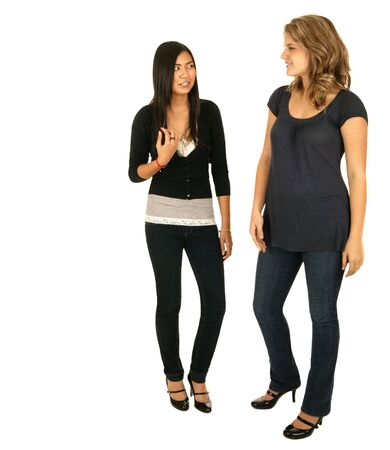 vietnamse: isolated asian and caucasian girls standing and chatting with each other Stock Photo