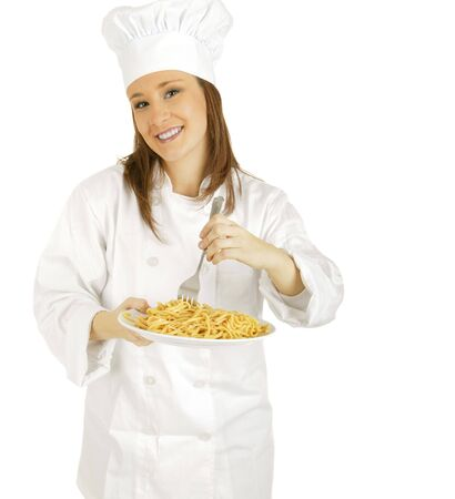 caucasian chef looking at camera while stirring pasta photo